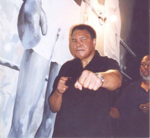 Muhammad Ali in our lobby in front of a mural of his most famous knockout
